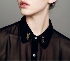 ysl on black sheer blouse collar