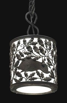 EDGAR BRANDT (1880-1960) A LANTERN, CIRCA 1925-26 wrought-iron and frosted glass 8 in. (20.3 cm.) high, 8 in. (20.3 cm.) diameter stamped E. Brandt