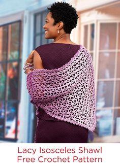 Lacy Isosceles Crochet Shawl Free Crochet Pattern in Red Heart Super Saver Ombré yarn -- The amazing ombre yarn colors move from light to dark and back again so you get that gradient look without changing skeins. Crochet this pretty lacy pattern as a perfect gift….or enjoy it yourself!