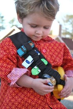 Snack bandolier -- perfect for two-year-olds who like to carry things. by janis
