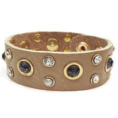 "This leather cuff is constructed of genuine leather, has a snap-on feature and is accented in rhinestones all the way around. Material: Genuine Leather - Size: 8.5"" Long x 2"" Wide - Color: Black $49.99"