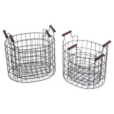 These openwork iron baskets showcase wood handles for a touch of rustic charm. Use them to stow throws and magazines or fill one with decorative orbs to crea...