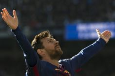 """Barcelona's Argentinian forward Lionel Messi celebrates after scoring during the Spanish League """"Clasico"""" football match Real Madrid CF vs FC Barcelona at the Santiago Bernabeu stadium in Madrid on December 23, 2017.  / AFP PHOTO / CURTO DE LA TORRE"""
