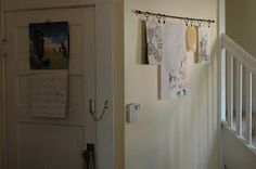 Hanging kids' artwork on a curtain rod! Easy to hang & change their art often. (Also helpful for drying artwork too.)