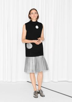 Light and airy, this ladylike skirt features broad box pleats that add playful volume to the silhouette.