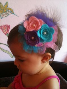 I don't normally like big headband accessories on babies, but this is adorable