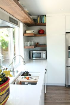 All white kitchen with open shelves // @kohlerco