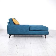 """- Beautiful teal chaise sofa with a yellow pillow - Classic Mid-Century style design - Seat height is 20"""" - Great condition with minimal wear"""