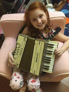 Lucy with her new accordion!  www.AtlantaIrishMusicSchool.com Accordion Sheet Music, Music School, Chanel Boy Bag, Irish, Atlanta, Shoulder Bag, Bags, Handbags, Irish Language