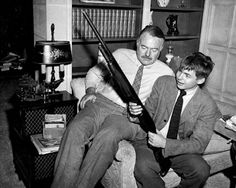 Photo: Ernest Hemingway & Patrick (mouse) Hemingway with gun in Idaho Copyright unknown courtesy J. Ernest Hemingway, Kate Smith, The Sun Also Rises, Raymond Chandler, Presidential Libraries, Crazy Man, S Stories, Atheist, Idaho
