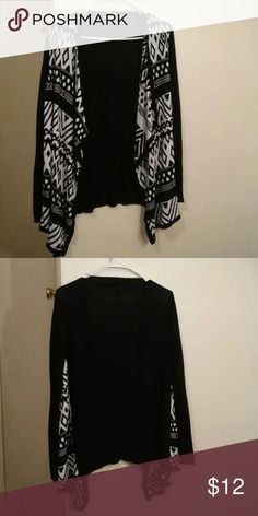 Nwot black and white Aztec cardigan Nwot Size medium black and white Aztec cardigan. Tried on once but was too big. I cut the tag off because it was itchy. In brand new condition Sweaters Cardigans