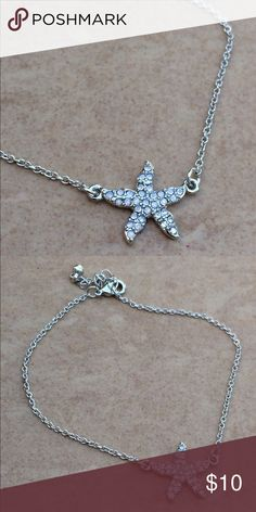 Silver Tone Crystal Starfish Anklet Ankle Bracelet Silver tone anklet features a cable link chain with a starfish attached at the center.  The starfish is set with iridescent crystals.  Anklet measures 9 inches long plus a 1 3/4 inch adjustable length extender chain with a lobster claw clasp. Jewelry Bracelets