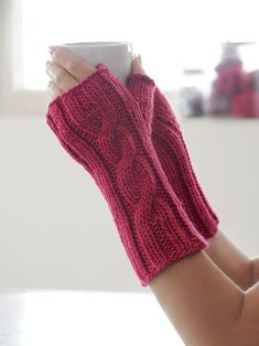 Free Knitting Pattern for One Cable Mitts - Rated easy by Ravelrers.  Knit in the round. Aran weight yarn. Designed by Blue Sky Fibers