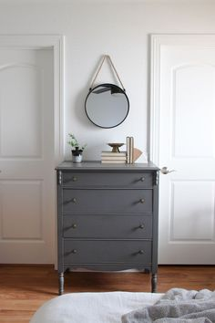 Vintage dresser with hanging mirror in master bedroom | Lumber Loves Lace | lumberloveslace.com