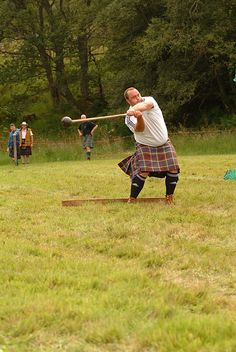 Glen Isla Highland Games, Throwing the Hammer. The Highlander is wearing the Anderson tartan of Clan Anderson.