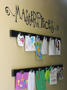 Masterpieces! Cute way to display child art..Adysens playroom. chalkboard underneath and the word ART above it..I have the perfect wall for this