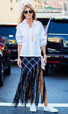 Wanna wear a maxi skirt without looking dated? Style Tip: Snag a statement maxi skirt and wear an untucked white button-down on top. Add sneakers for good measure.