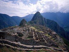 Machu Picchu is a pre-Columbian 15th-century Inca site located 2,430 metres above sea level in the Cusco Region of Peru, South America
