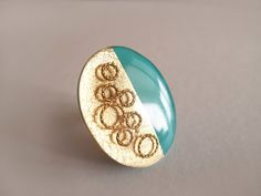 ***You can click on the image for larger view to see more details.    This beautiful adjustable ring i have made from polymer clay, gold leaf, gold