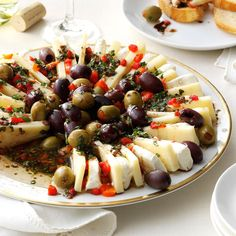 We love to make meals into celebrations, and antipasto always kicks off the party for Italian dinners. This one is almost too pretty to eat, especially when sprinkled with pimientos, fresh basil and parsley. —Patricia Harmon, Baden, Pennsylvania