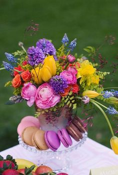 colorful centerpiece with tulips, hyacinth, roses, ranunculus, muscari and daffodils