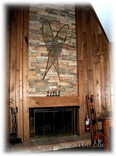 The snowshoes on the fireplace are such a cute idea