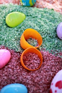 Easter Egg Sensory Bin with colored and scented rice - The plastic eggs are perfect for toddlers to scoop and dump.  For extra fun hide little surprises in the eggs!