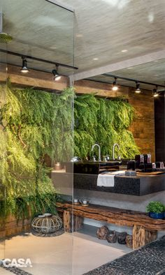 Love this garden wall in the bathroom