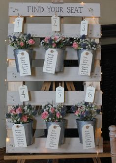 rustic table plan with colourful flowers
