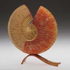 Bob Chapman's 'Sunrise' turned, cut, carved, painted, strung Sycamore.