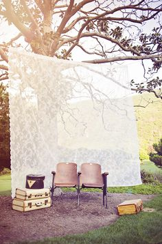 photo booth with lace back drop - love! easily done with tablecloth, fabric, or even curtains!