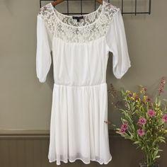 HeartSoul Lace Dress White dress with lace around shoulders. Sheer 3/4 length sleeve. Elastic waist. HeartSoul Dresses Mini