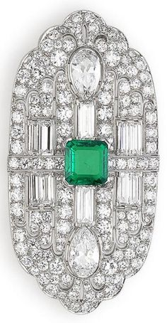 An Art Deco Emerald and Diamond Brooch, by J.E. Caldwell, Circa 1925. The step-cut emerald, weighing 2.30 carats, set with old brilliant and baguette-cut diamonds, highlighted by a pair of pear-shaped diamonds, signed J.E.C. & Co, numbered, width 6.0cm. #Caldwell #ArtDeco #brooch