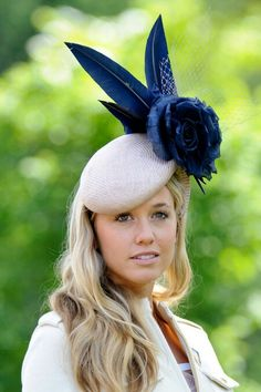 Cream fascinator with navy blue flowers
