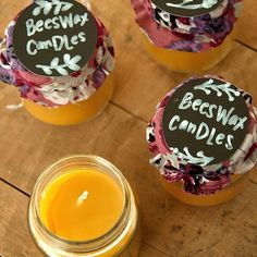 Chalkboard paper cutouts can easily be used as labels for gifts. Click the pic to see how to make and package these bottled beeswax candles.