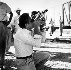 """James Dean with his Bolex camera on location for """"Giant"""" in Marfa, TX, 1955."""