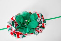This is such a beautiful Christmas headband! It has shabby flowers in green and red chevron with a green chiffon flower on a skinny green