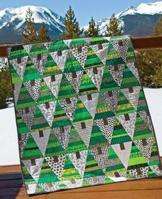 Dig deep into your scrap basket of quilting fabrics to make the Tree Farm wall quilt. This easy quilt project is a manageable 36