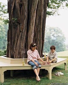 Great design idea for that big oak tree out back..  Wraparound Bench - Martha Stewart Home  Garden
