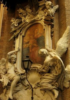 Angels holding a painting of the Blessed Virgin Mary and Child Jesus. Rome, near Piazza Navona.