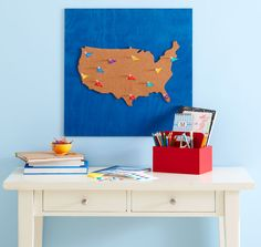 For the kids: bulletin board map to pin the places the family has visited