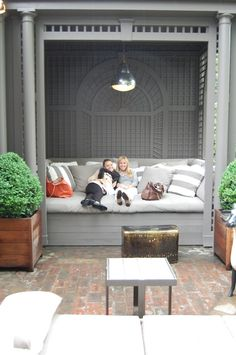 @Kari Hay! What about building something like this in when you do the porch instead of buying furniture. The you could just buy one chair and  whatever cushions you wanted to!