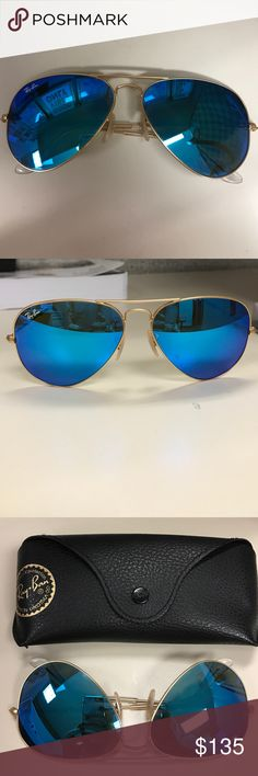Authentic Ray Ban Aviators with blue mirror lenses Ships today!!!!!  Authentic Ray Bans. Blue Flash lenses with a matte gold metal frame. No scratches. These are about a year old and in perfect condition. Case included. Ships next day, Monday - Friday! Ray-Ban Accessories Sunglasses