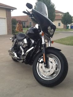 Harley Davidson fat bob with batwing fairing. And my hand made sissy bar with wood insert.