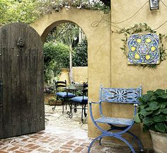 Archways, fences, hedges, and gates are great ways to divide a large yard into intimate spaces