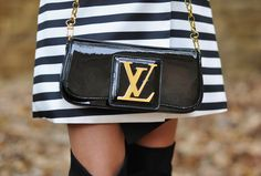 Striped coat and Louis Vuitton Clutch