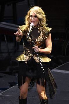 Carrie Underwood Photos Photos - Singer/songwriter Carrie Underwood performs during a stop of The Storyteller Tour at T-Mobile Arena on November 26, 2016 in Las Vegas, Nevada. - Carrie Underwood With Easton Corbin In Concert In Las Vegas