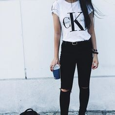 Looking for cool girl outfit inspiration? Pair a simple graphic tee (like this Calvin Klein Jeans ) with lightly ripped jeans. This outfit will carry your style throughout the entire day.