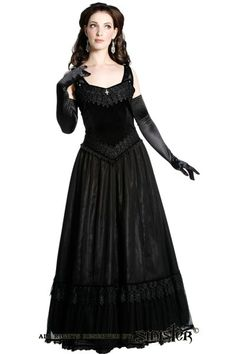 Chandra dress by Sinister has a black velvet fitted bodice with sweetheart neckline and V-shaped waistline, trimmed with broad black brocade lace along the neckline and waist.