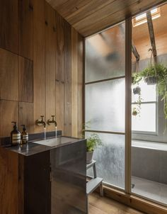 Fumed oak paneling in a London bath designed by architect Simon Astridge fromBathroom of the Week: A Japanese-Style Bath in London, Greenery Included.